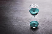 Sandglass, hourglass with sand. Time is running out. Speed of decision making in business.