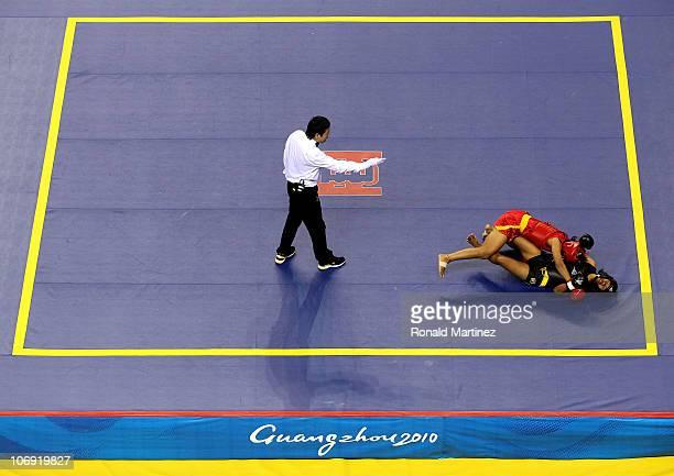 Sandhyarani Devi Wangkhem of India takes down Paloy Barckkham of Laos during the women's Sanshou 60kg Wushu at Nansha Gymnasium during day four of...