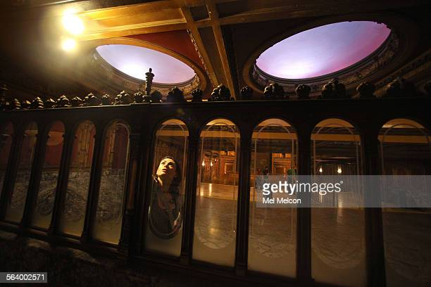 Sandi Hemmerlein member of the Los Angeles Historic Theatre Foundation looks up at a standee rail located at the back of the Tower Theatre on...