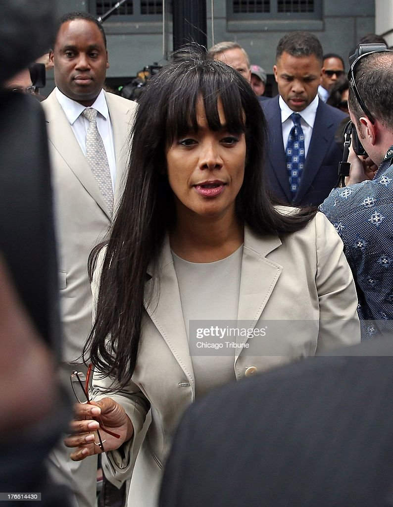 Sandi Jackson, wife of Jesse Jackson Jr., departs the federal courhouse in Washington, DC, after a sentencing hearing on Wednesday, August 14, 2013.