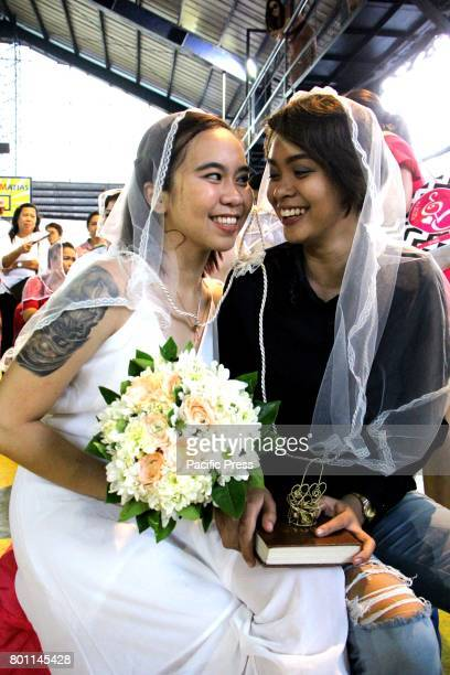 Sandie E Caluag 20 years old and Janica Karla P Nazario 24 years old t and ten months in relationship during their wedding ceremony on the Grand Mass...