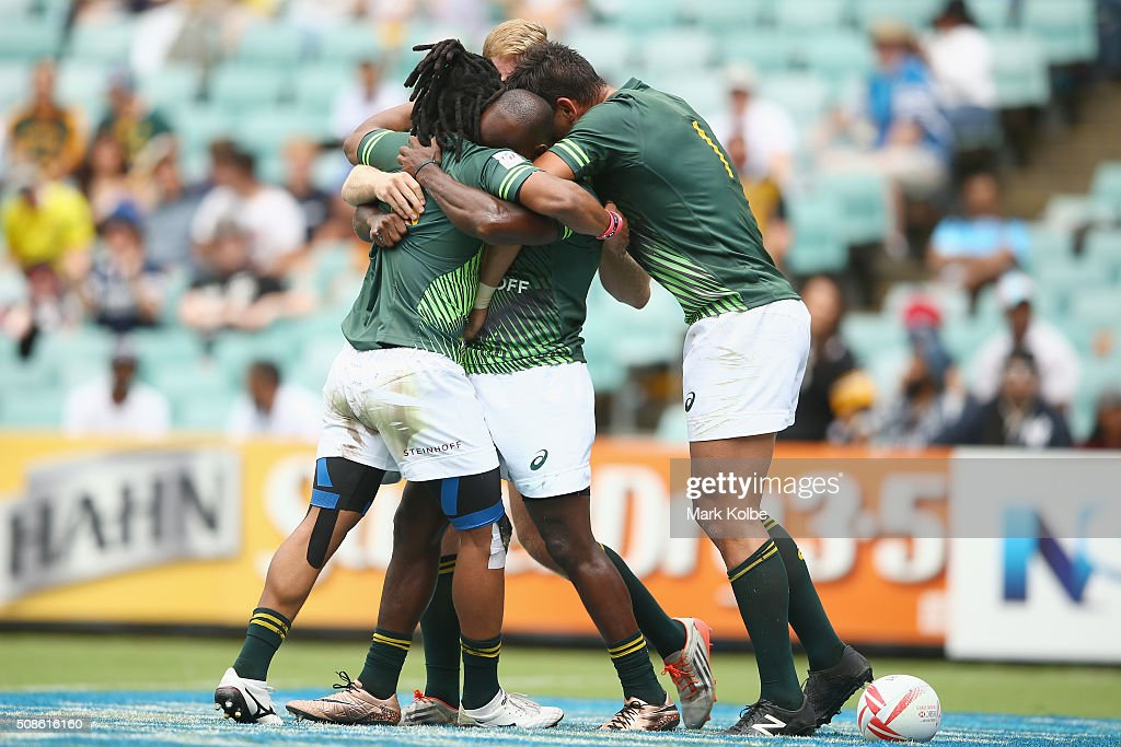Sandile Ngcobo of South Africa celebrates with his team mates after scoring a try during the 2016 Sydney Sevens match between South Africa and Scotland at Allianz Stadium on February 6, 2016 in Sydney, Australia.
