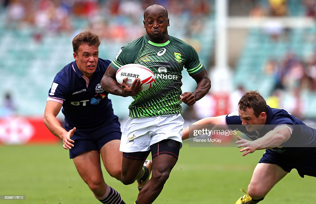 Sandile Ngcobo of South Africa gets away from the Scottish defence during the day 1 match between South Africa and Scotland at the HSBC Sydney Sevens at Allianz Stadium on February 06, 2016 in Sydney, Australia.