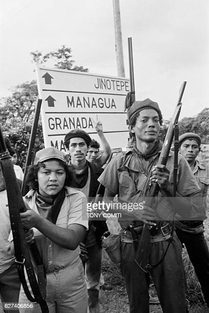 Sandinista guerrillas arrive triomphant in the Nicaraguan capital of Managua following the resignation and expropriation of Dictator Anastasio Somoza