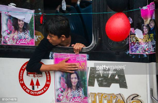 A sandinista rides on a bus heading for Masaya in Managua on July 7 2017 during the celebration of the 38th anniversary of 'El Repliegue' tactical...