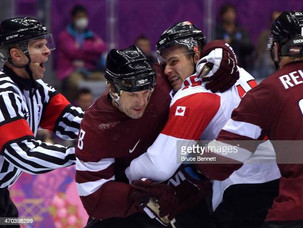 Sandis Ozolins of Latvia and Ryan Getzlaf of Canada shove each other during the Men's Ice Hockey Quarterfinal Playoff on Day 12 of the 2014 Sochi...