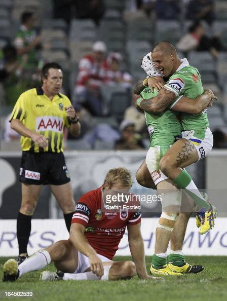 Sandor Earl congratulates Jarrod Croker of the Raiders after scoring a try during the round three NRL match between the Canberra Raiders and the St...