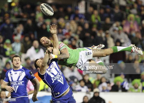 Sandor Earl of the Raiders and Jonathan Wright of the Bulldogs contest a high ball during the round 25 NRL match between the Canberra Raiders and the...