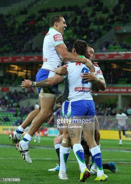 Sandor Earl of the Raiders celebrates his try with teamates during the round 18 NRL match between the Melbourne Storm and the Canberra Raiders at...