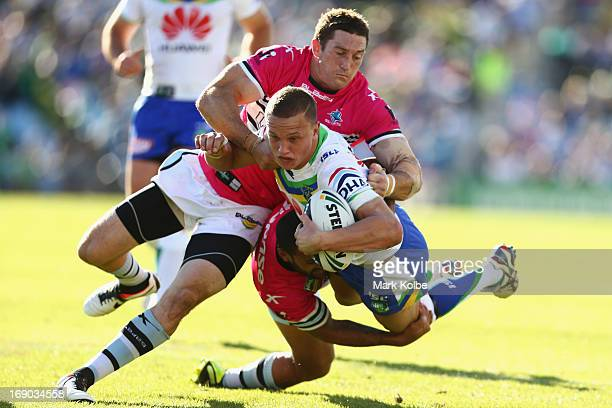 Sandor Earl of the Raiders is tackled during the round 10 NRL match between the Cronulla Sharks and the Canberra Raiders at Sharks Stadium on May 19...