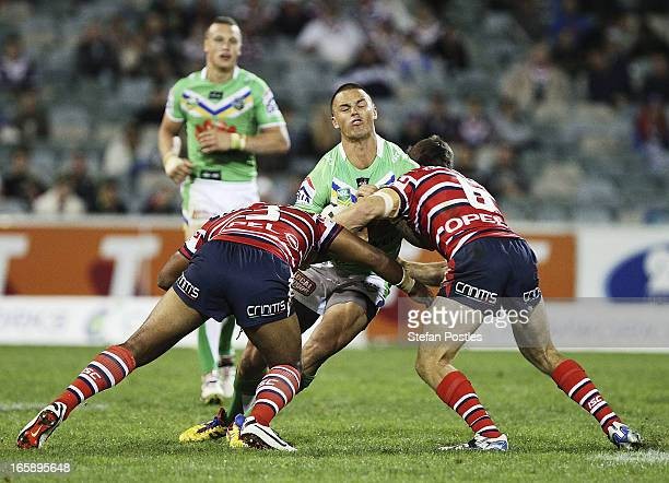 Sandor Earl of the Raiders is tackled during the round five NRL match between the Canberra Raiders and the Sydney Roosters at Canberra Stadium on...