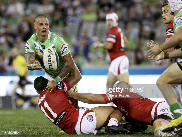 Sandor Earl of the Raiders off loads the ball during the round three NRL match between the Canberra Raiders and the St George Illawarra Dragons at...