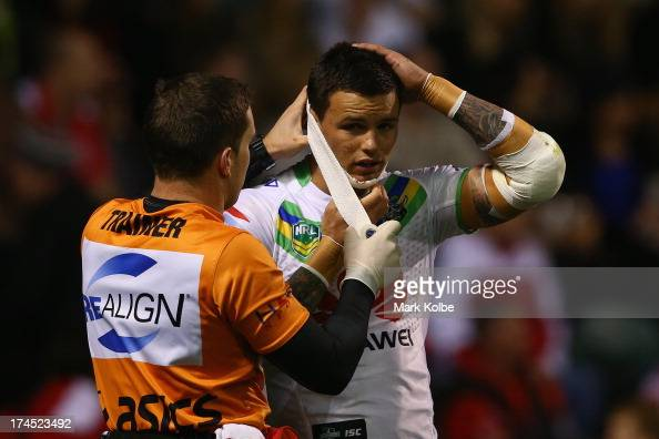Sandor Earl of the Raiders receives a bandage for chin wound during the round 20 match between the St George Illawarra Dragons and the Canberra...
