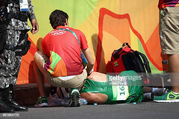 Sandor Racz of Hungary is assisted by medical staff during the Men's 50km Race Walk on Day 14 of the Rio 2016 Olympic Games at Pontal on August 19...