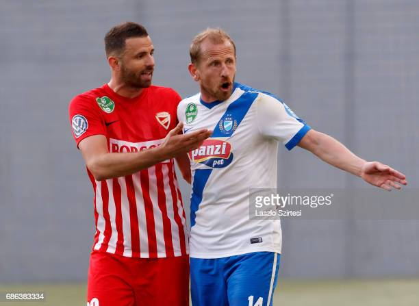 Sandor Torghelle of MTK Budapest argues with Attila Busai of DVTK about a foul during the Hungarian OTP Bank Liga match between MTK Budapest and DVTK...