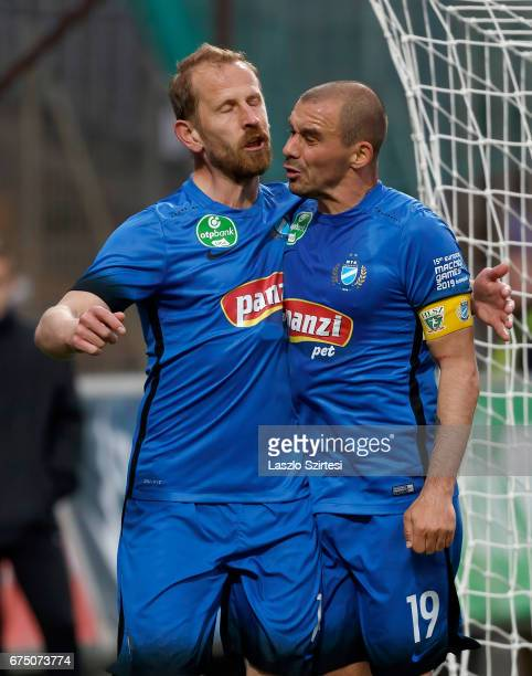 Sandor Torghelle of MTK Budapest celebrates his goal with Jozsef Kanta of MTK Budapest during the Hungarian OTP Bank Liga match between Ujpest FC and...