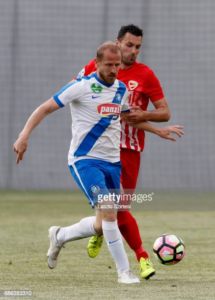 Sandor Torghelle of MTK Budapest competes for the ball with Dejan Karan of DVTK during the Hungarian OTP Bank Liga match between MTK Budapest and...