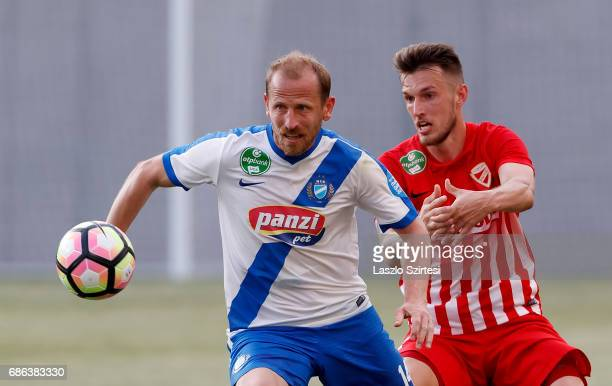Sandor Torghelle of MTK Budapest competes for the ball with Mark Tamas of DVTK during the Hungarian OTP Bank Liga match between MTK Budapest and DVTK...
