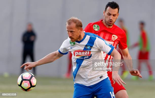 Sandor Torghelle of MTK Budapest wins the ball from Dejan Karan of DVTK during the Hungarian OTP Bank Liga match between MTK Budapest and DVTK at...