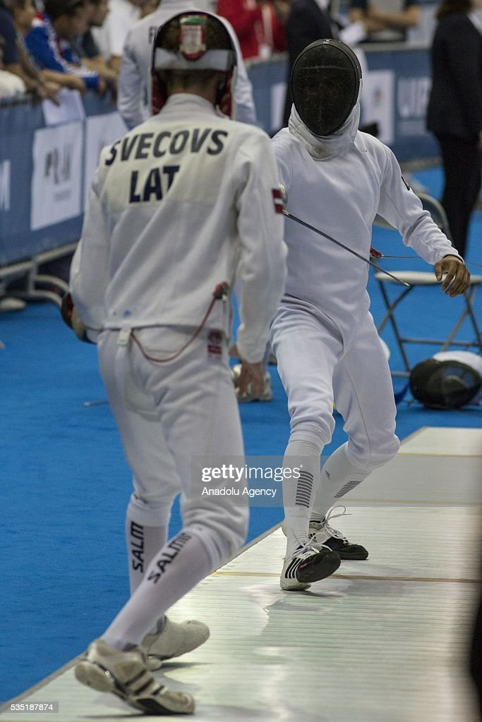 Sandoval Alvaro (R) from Mexico and Svecovs Pavels from Latvia compete in the fencing at the mixed relay World Championship in modern pentathlon in Olympic Sports Complex in Moscow, Russia, on May 29, 2016.