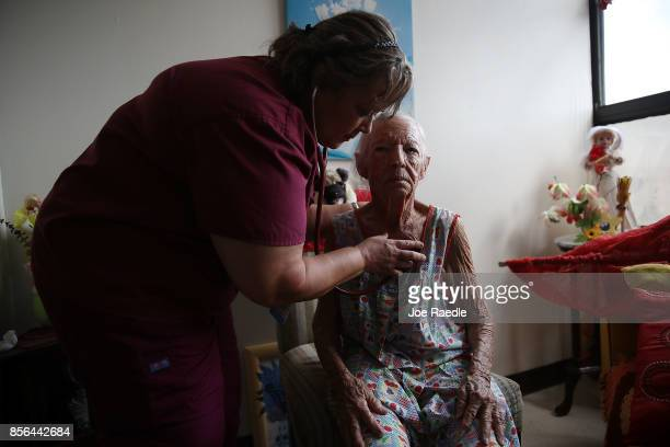 Sandra Alvarez MD from the First Medical Relief team gives Mercedes Perez a health care checkup in her apartment at the Pedro America Pagan de Colon...