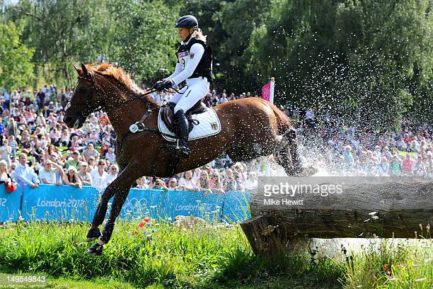 Sandra Auffarth of Germany riding Opgun Louvo negotiates a jump in the Eventing Cross Country Equestrian event on Day 3 of the London 2012 Olympic...