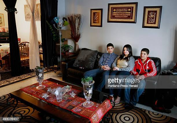 Sandra Banijameel relaxes on the couch of her Westbrook home with brothers Ahmed at left and Mohammed at right Wednesday March 20 2013 The Banijameel...