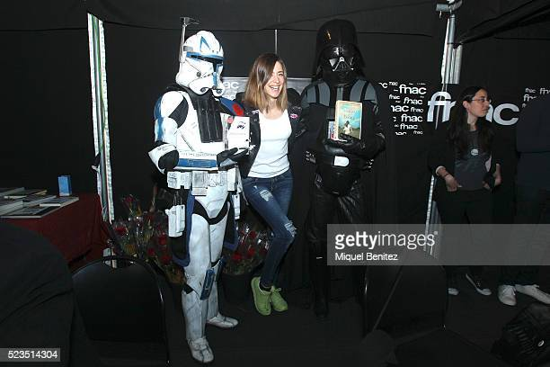 Sandra Barneda poses with two Star Wars characters Darth Vader during 'Sant Jordi's Day' 'Saint George's Day' on April 23 2016 in Barcelona Spain