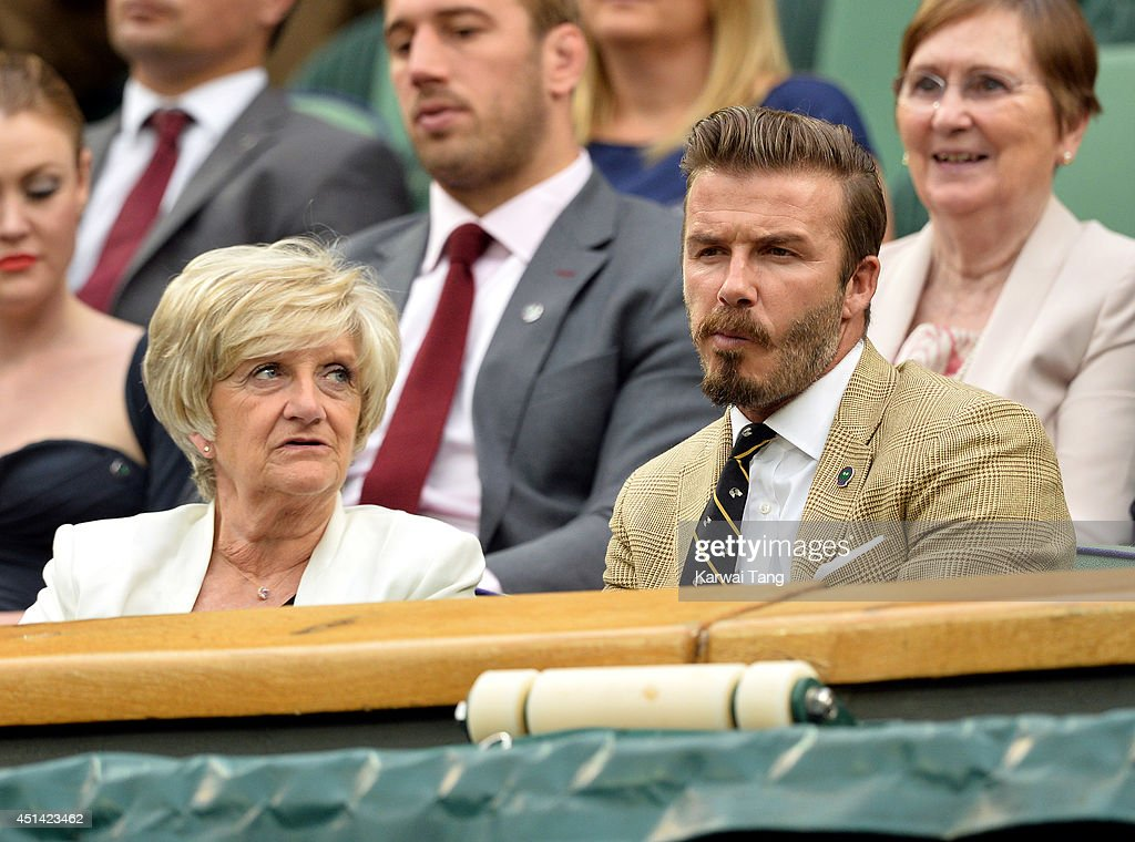 Sandra Beckham and David Beckham attend the Mikhail Kuskushkin v Rafael Nadal match on centre court during day six of the Wimbledon Championships at Wimbledon on June 28, 2014 in London, England.