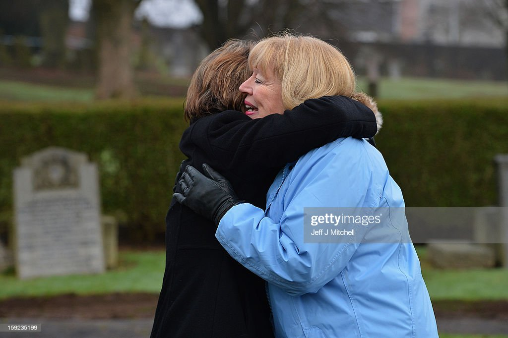 Sandra Brown hugs Ann Taylor from the Moira Anderson Foundation following the conformation that a grave at Old Monkton cemetery does not contain the body of missing schoolgirl Mora Anderson on January 10, 2013 in Coatbridge, Scotland. Forensic specialist have spent the past three days exhuming the family burial plot of Sinclair Upton, an acquaintance of Alexander Gartshore, a former bus driver and convicted rapist linked to the disappearance of Moira. The 11-year-old school girl went missing in 1957.