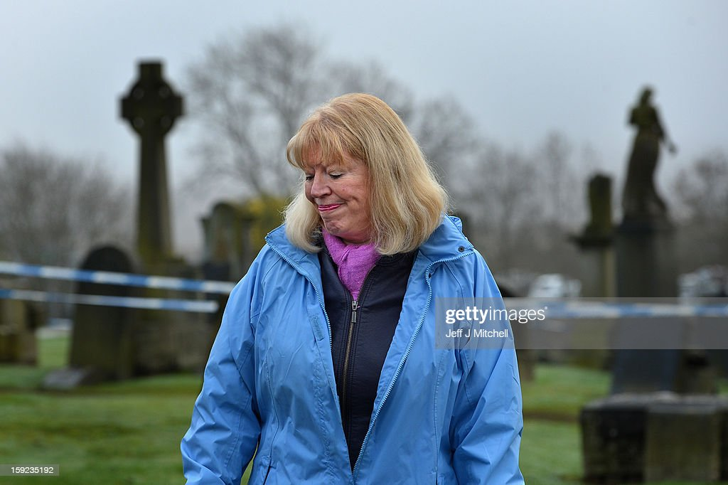 Sandra Brown reacts following the conformation that a grave at Old Monkton cemetery does not contain the body of missing schoolgirl Mora Anderson on January 10, 2013 in Coatbridge, Scotland. Forensic specialist have spent the past three days exhuming the family burial plot of Sinclair Upton, an acquaintance of Alexander Gartshore, a former bus driver and convicted rapist linked to the disappearance of Moira. Mrs Brown believes that her late father Alexander Gartshore had some involvement in the abduction and murder of the 11-year-old school girl went missing in 1957.