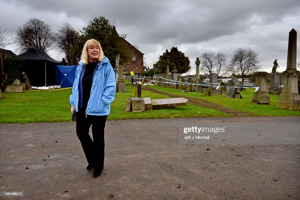 Sandra Brown talks with media gathered at Old Monkland Cemetery as forensic officers continue examining a burial plot on January 9, 2013 in Coatbridge, Scotland. Mrs Brown believes that her late father Alexander Gartshore, a former bus driver and convicted rapist, had some involvement in the abduction and murder of schoolgirl Moira Anderson. Forensic specialists are exhuming remains at a gravesite, in search of the 11 year old school girl, who went missing in 1957.