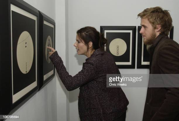 Sandra Bullock and Ryan Gosling attend the artist's reception for photographer Dan Winters' gallery showing entitled 'La Ciudad' Saturday September...