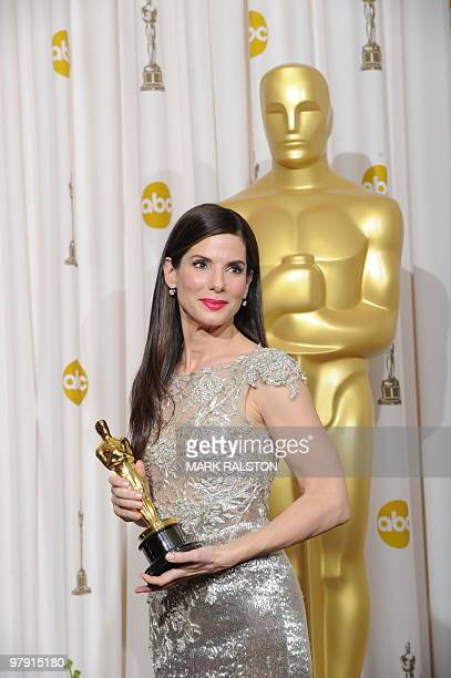 Sandra Bullock celebrates winning her Oscar for best actress during the 82nd Academy Awards at the Kodak Theater in Hollywood California on March 7...