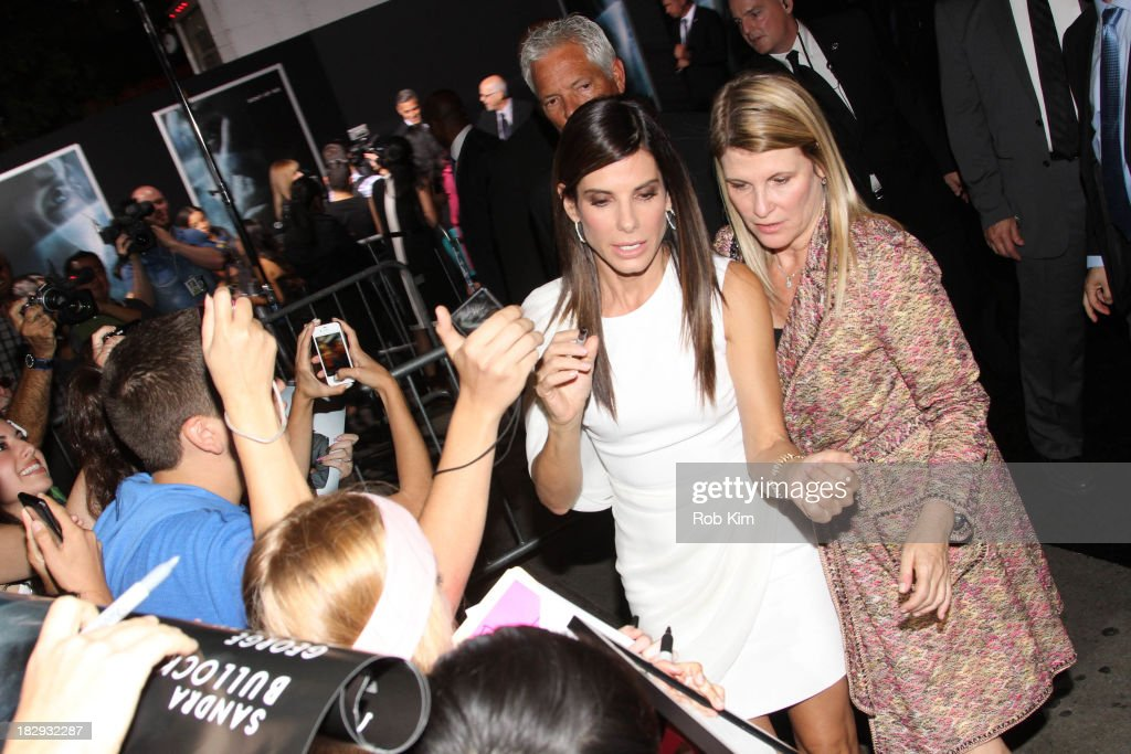 <a gi-track='captionPersonalityLinkClicked' href=/galleries/search?phrase=Sandra+Bullock&family=editorial&specificpeople=202248 ng-click='$event.stopPropagation()'>Sandra Bullock</a> greets fans during arrivals for the 'Gravity' premiere at AMC Lincoln Square Theater on October 1, 2013 in New York City.