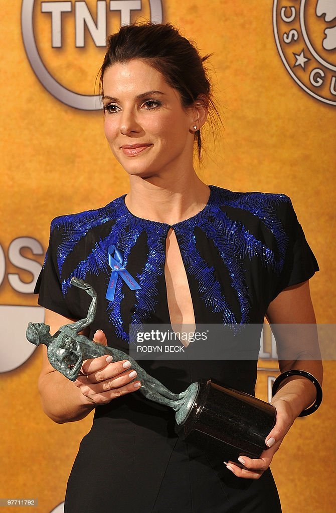 <a gi-track='captionPersonalityLinkClicked' href=/galleries/search?phrase=Sandra+Bullock&family=editorial&specificpeople=202248 ng-click='$event.stopPropagation()'>Sandra Bullock</a> holds her trophy for Outstanding Performance by a Female Actor in a Leading Role in 'The Blind Side' at the 16th annual Screen Actors Guild Awards (SAG) at the Shrine Exposition Center in Los Angeles January 23, 2010. AFP PHOTO / ROBYN BECK