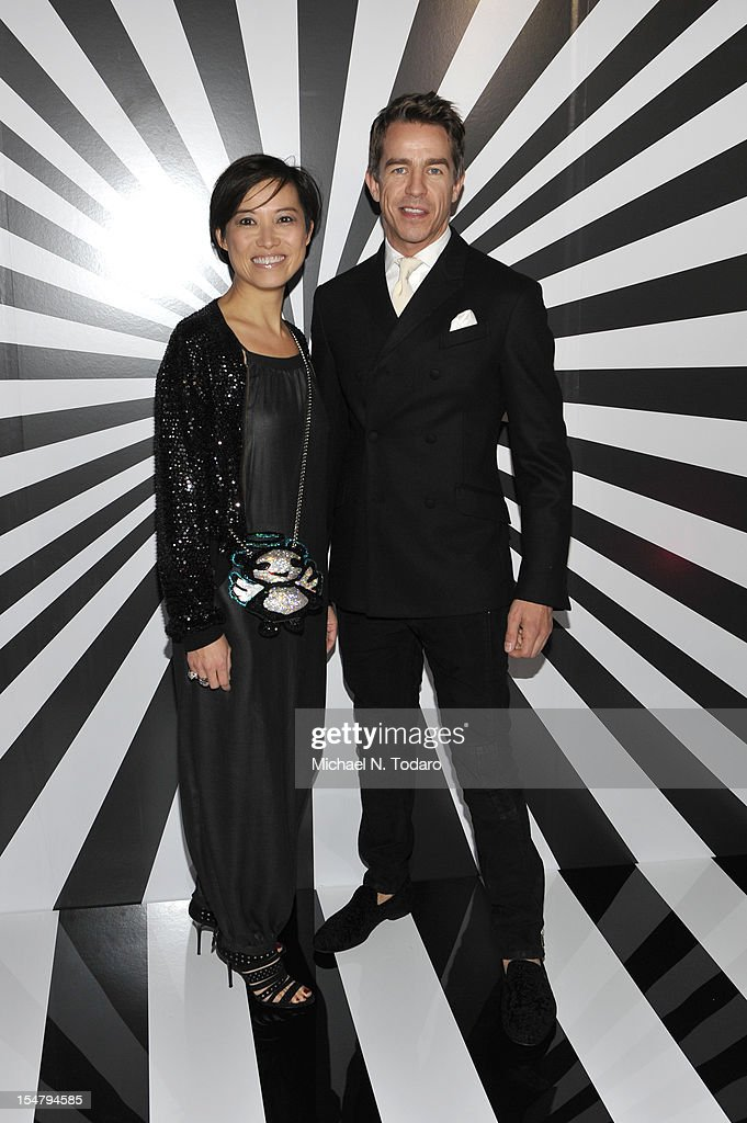Sandra Choi and Simon Holloway attend the celebration of the collaboration between Jimmy Choo and Artist Rob Pruitt at The Fletcher Sinclair Mansion on October 25, 2012 in New York City.