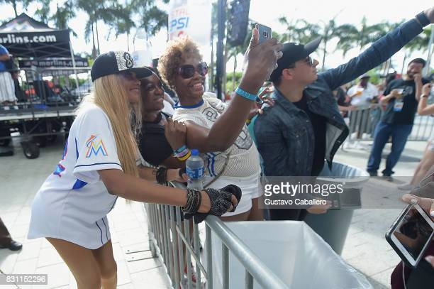 Sandra Denton of SaltNPepa poses with fans At The Crystal Pepsi Throwback Tour At Marlin's Park on August 13 2017 in Miami Florida