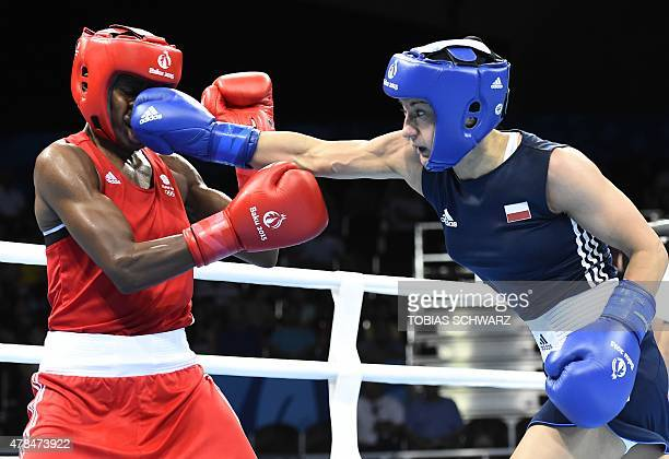 Sandra Drabik of Poland lands a punch on Nicola Adams of Britain during the final fight of the women's fly weight boxing event at the 2015 European...