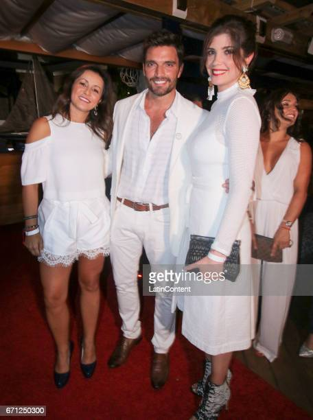 Sandra Duque Julian Gil and Andrea Noceti pose at River Yatch Club during the US launch of Carson Life on April 20 2017 in Miami Us
