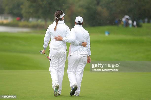Sandra Gal and Caroline Masson of the European Team leave the court after the 18th hole during the continuation of the afternoon fourball matches on...
