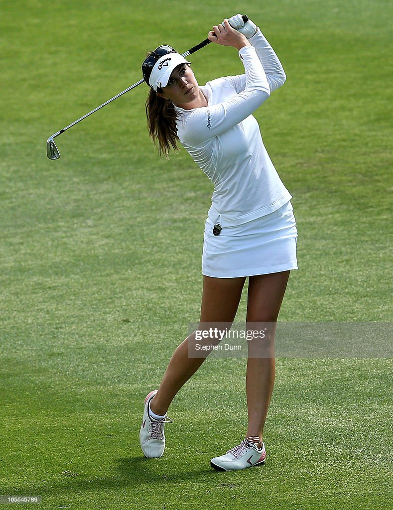 <a gi-track='captionPersonalityLinkClicked' href=/galleries/search?phrase=Sandra+Gal&family=editorial&specificpeople=2646550 ng-click='$event.stopPropagation()'>Sandra Gal</a> of Germany hits her second shot on the seventh hole during the first round of the Kraft Nabisco Championship at Mission Hills Country Club on April 4, 2013 in Rancho Mirage, California.