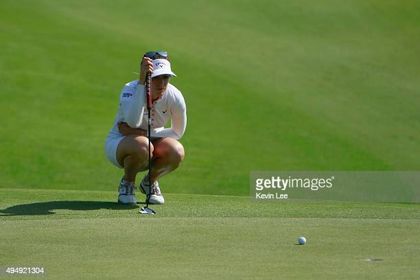 Sandra Gal of Germany lines up her putt at the 18th hole in round 2 on Day 5 of Blue Bay LPGA 2015 at Jian Lake Blue Bay golf course on October 30...