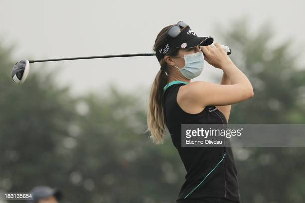 Sandra Gal of Germany plays a tee shot wearing a protective mask during the third round of the Reignwood LPGA Classic at Pine Valley Golf Club on...