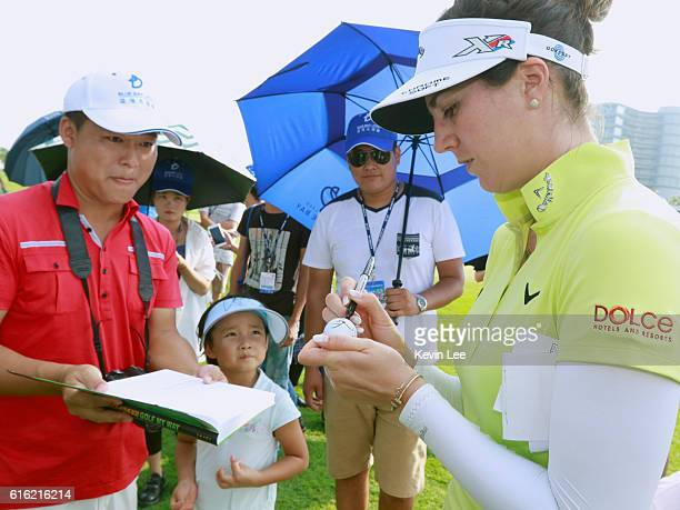 Sandra Gal of Germany sign a ball for fans after her match on the 18th green during Round 3 of Blue Bay LPGA on Day 3 on October 22 2016 in Hainan...