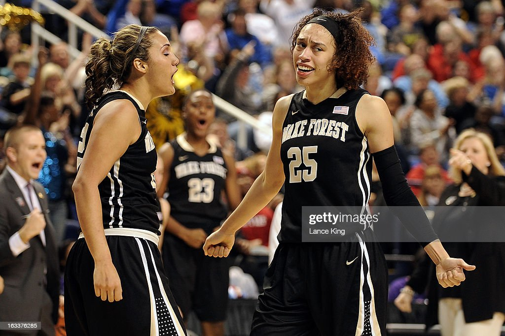 Sandra Garcia #21 and Dearica Hamby #25 of the Wake Forest Demon Deacons react following a play against the Maryland Terrapins during the quarterfinals of the 2013 Women's ACC Tournament at the Greensboro Coliseum on March 8, 2013 in Greensboro, North Carolina.