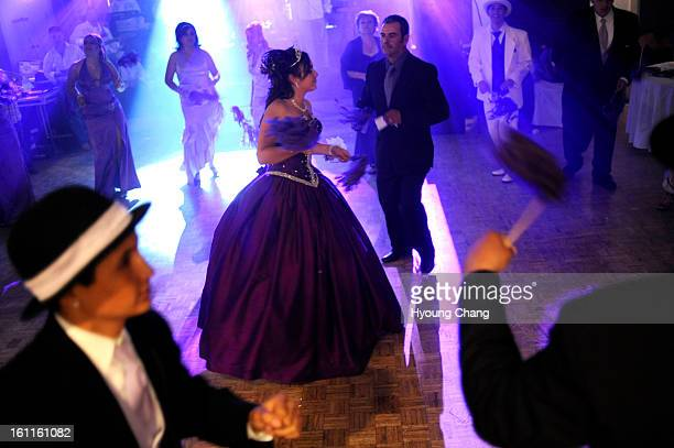 Sandra Gutierrez center is dancing with her fathher Jose Guiterrez top right for her Quinceanera at the dance hall of Country Inn at Grand Junction...