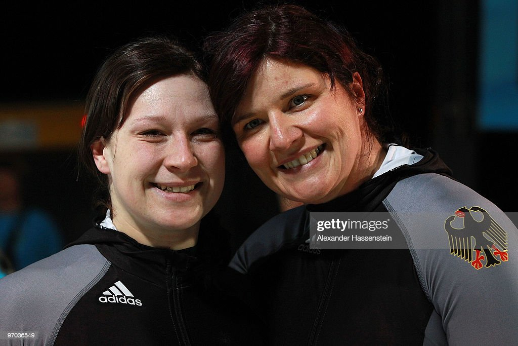 Sandra Kiriasis and Christin Senkel of Germany celebrate their fourth run during the women's bobsleigh on day 13 of the 2010 Vancouver Winter...