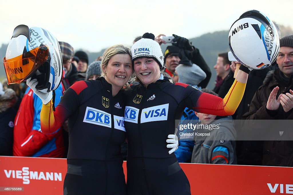 Sandra Kiriasis and Franziska Fritz of Germany celebrate their victory of bob women competition during the FIBT Bob Skeleton World Cup at Bobbahn...