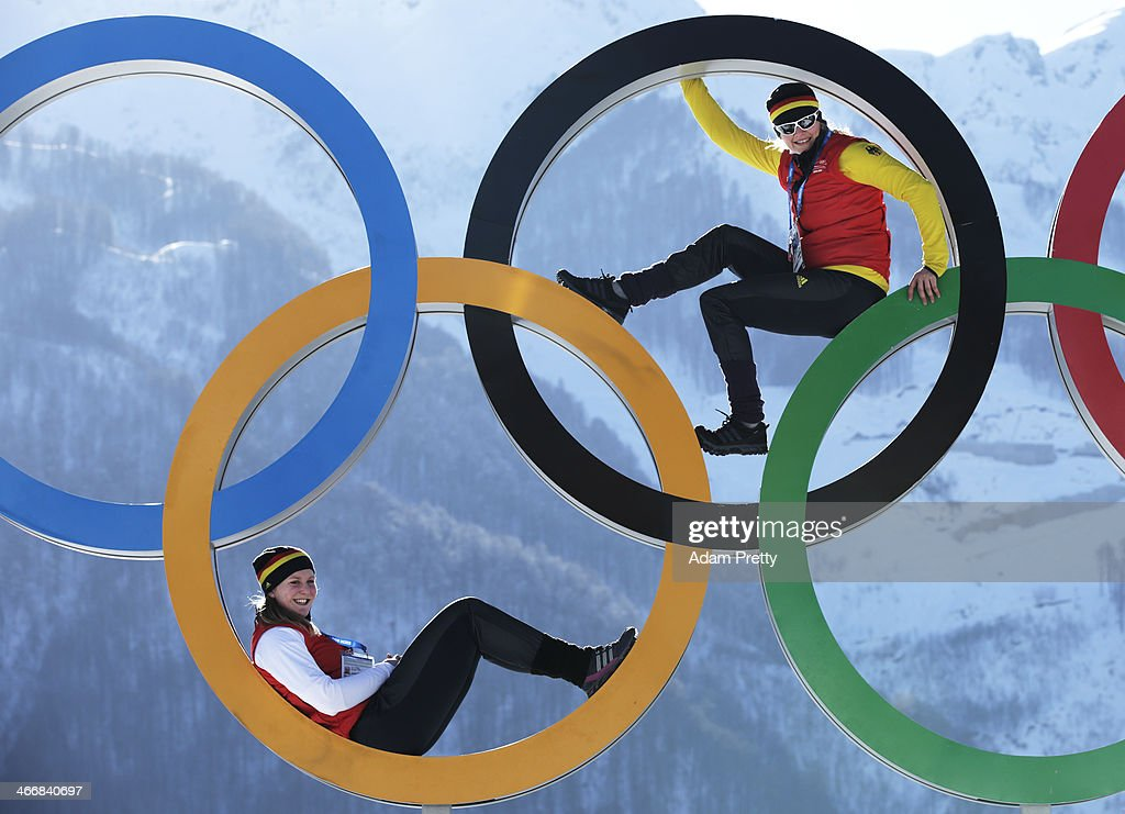Sandra Kiriasis and Franziska Fritz of Germany pose for a picture with the Olympic Rings at the Athletes Village ahead of the Sochi 2014 Winter...